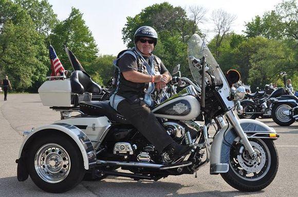 man on 2001 road king police voyager trike