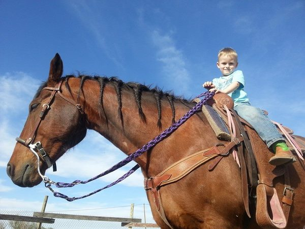 kid riding horse