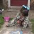 girl-playing-front-yard-stranger
