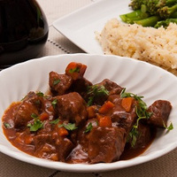 Braised beef in rich tomato and anchovy sauce Recipe