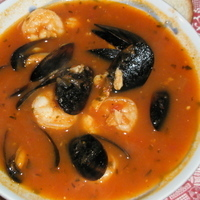 Cioppino With Crab, Shrimp, And Mussels Served With Fresh Baked French Bread... Made With Leftover Tomato Basil Soup Recipe