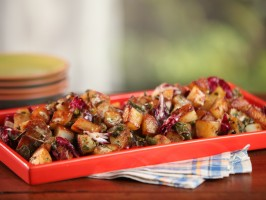 Cast-Iron Home Fries with Roasted Green Chiles, Cilantro, Green Onions, Radicchio, and Creamy Garlic Dressing