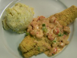 Fried Catfish topped with Crawfish Au Gratin Sauce