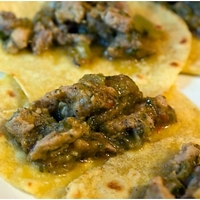 Pork Tacos cooked in a spicy green chili sauce Recipe