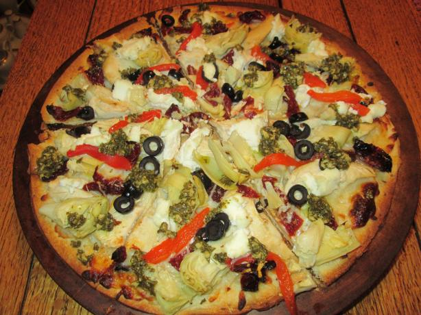 Artichoke, Pesto & Sun-Dried Tomato Pizza With Three Cheeses