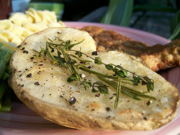 Roasted Potato Halves With Herb Sprigs
