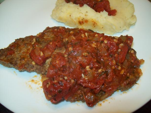 Greek Keftethes Covered in Tomato Sauce