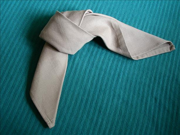 Serviette/Napkin Folding, Tied in a Loose Knot.