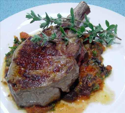 Veal cutlets with olive, tomato and anchovy sauce