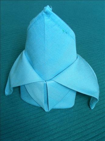 Serviette/Napkin Folding, Fleur De Lis Variation.