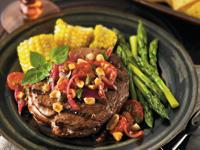 Rib Eye Steak With a Roasted Tomato, Peanut and Jalapeno Relish