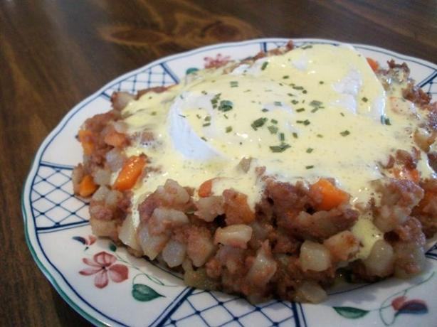 Corned Beef Hash With Poached Eggs Under Hollandaise