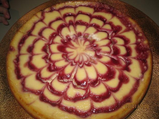 Vanilla Cheesecake With Chocolate Hazelnut Crust and Raspberries