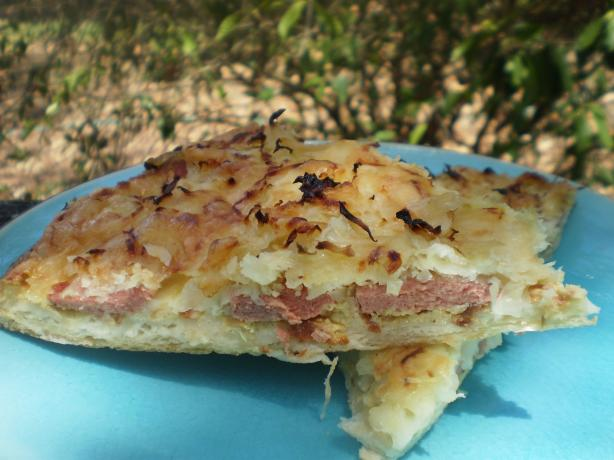 Pizza With Sausage, Sauerkraut & Swiss Cheese