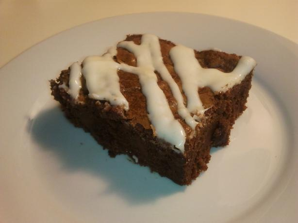 Dark Chocolate Chunk Brownies With Sweet Cream Cheese Drizzle