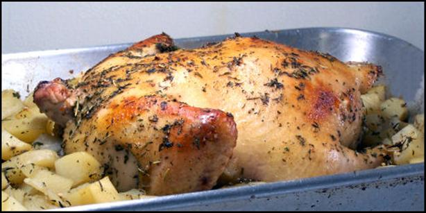Roast Chicken Stuffed with Herbed Potatoes