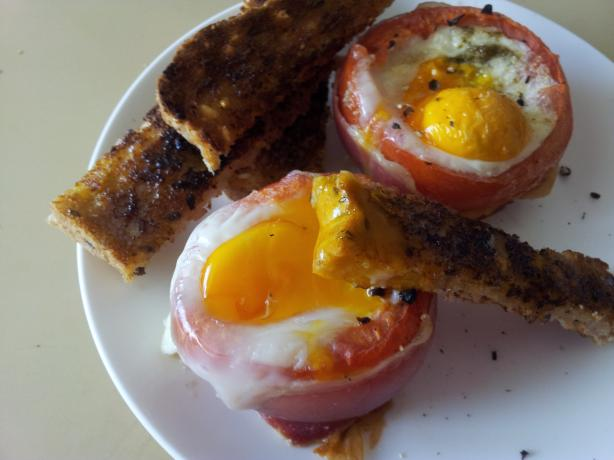 Eggs Baked in Tomatoes With Prosciutto & Basil
