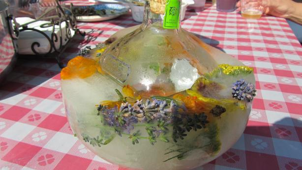 Frozen Festive Vodka or Tequila Bottles With Herbs and Berries