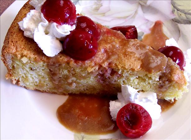 Pine Nut Cake With Poached Cherries and Caramel Sauce