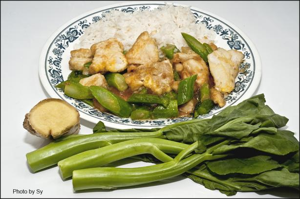 Sliced Fish With Chinese Broccoli on White Rice