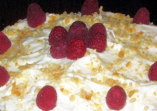 Raspberry Filled Cake With White Chocolate and Macadamias