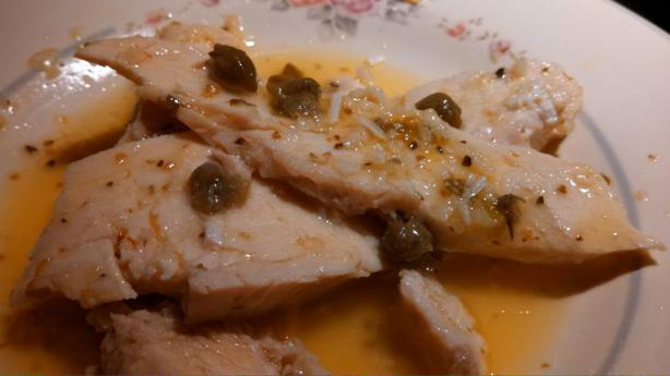 Poached Chicken in Olive Oil, Garlic, and Green Peppercorn Sauce