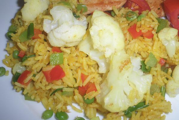 Curried Rice With Cauliflower and Peas