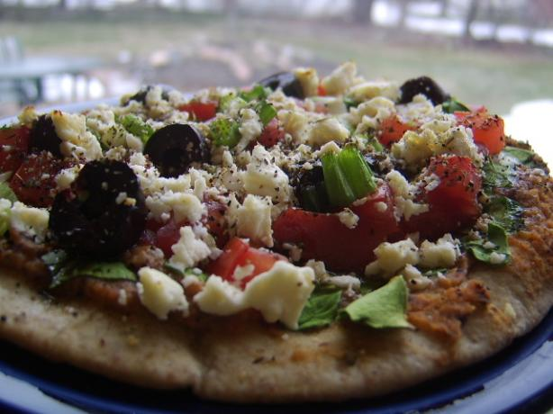 Pita Pizzas With Hummus, Spinach, Olives, Tomatoes & Cheese