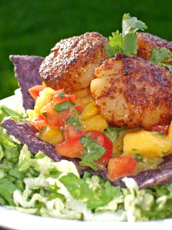 A Salad of Seared Scallops, Mango Salsa and Tortilla Strips