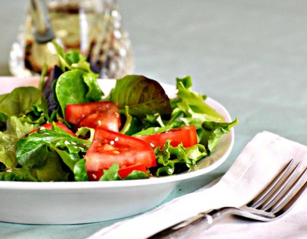 A Salad of Arugula (Rocket), Cherry Tomatoes and Sesame Seed