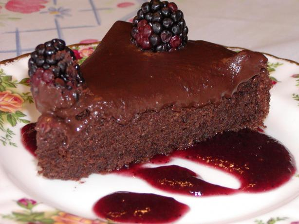 Decadent Chocolate Cake on a Bed of Raspberry Sauce
