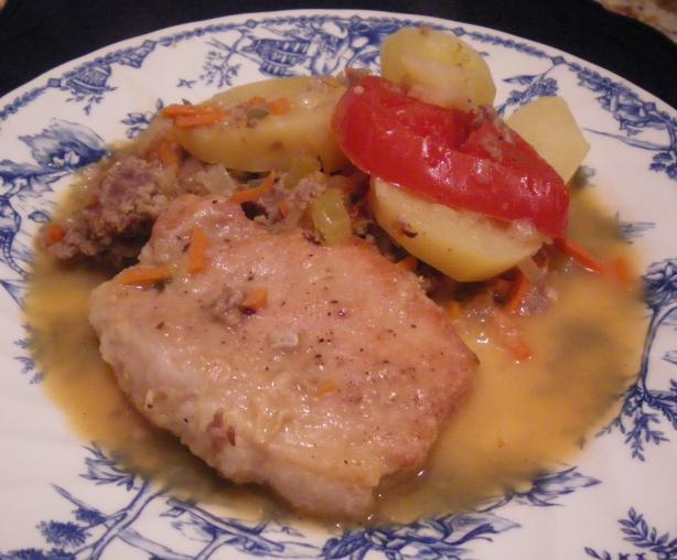 Schweinskoteletten Mit Bratwurt Und Kartoffeln
