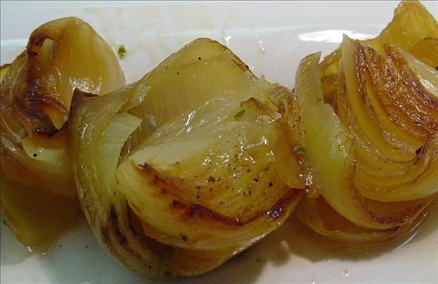 Roasted Onions on a Bed of Herbs