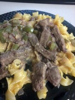 Steak Grillades over Cheese Noodles