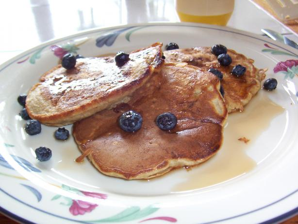 Banana Pecan Pancakes Served With Berries