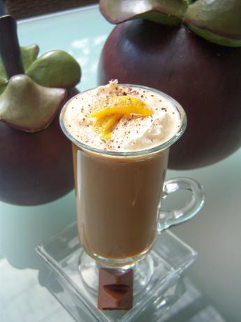 Orange Coffee Topped With Honey Nougat Chocolate And Orange Peel
