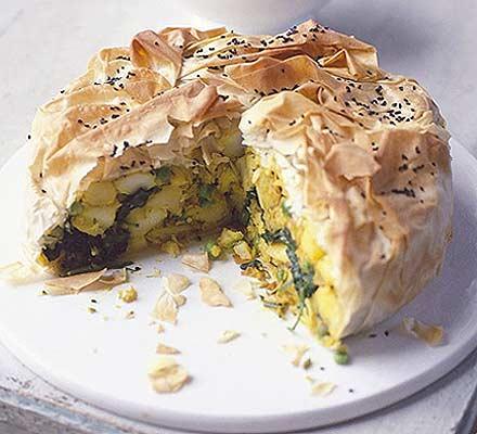 Spiced potato cake with mint raita