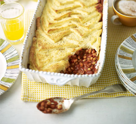 Smoky bean, bacon & eggy bread bake