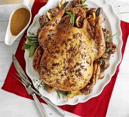 Roast turkey with pecan, sausage & chestnut stuffing & roast shallots
