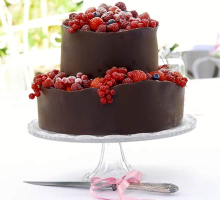 Orange berry wedding cake