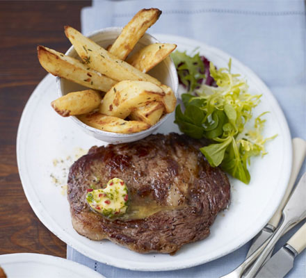 Rib-eye steaks with chilli butter & homemade chips