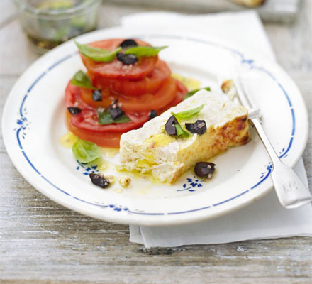 Parmesan-baked ricotta with tomato, olive & basil salad