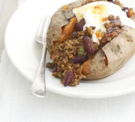 Baked sweet potatoes with easy chilli & soured cream