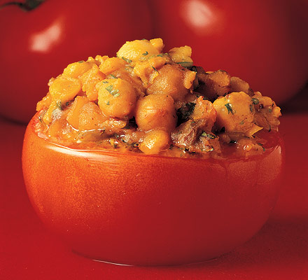 Tomatoes stuffed with fruity dhal