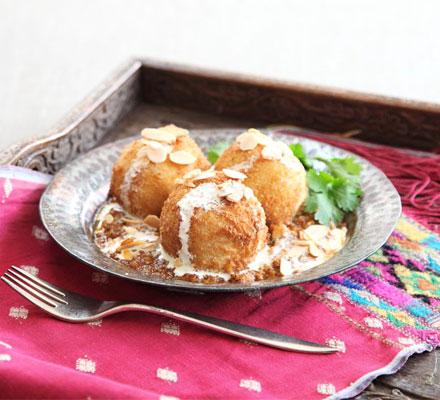 Malai kofta with spicy gravy