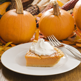 Carved Pumpkin Cheesecake with Caramelized Pecans