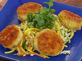 Avocado and Blue Crab Cakes with a Mango, Papaya and Macadamia Nut Salad Tossed with Spicy Cilantro Dressing