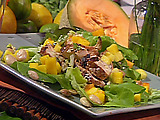 Marinated and Grilled Chicken Salad with Tropical Fruits, Marcona Almonds, Baby Lettuces and Lemon-Ginger Vinaigrette