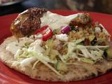 Moroccan Chicken with Shredded Cabbage and Tahini Sauce on Pita
