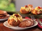 Black Pepper Popovers filled with Vermont Cheddar and Herb Scrambled Eggs and Maple-Mustard Glazed Canadian Bacon